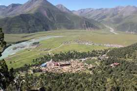 Reting forest, Reting Monastery and the Kyi Chu valley with treeles slopes around.